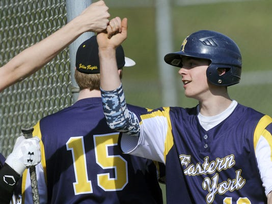 Eastern York's Robert Hedrick celebrates crossing home plate during the Golden Knights' 6-2 victory against York Suburban on Monday.