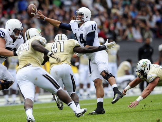 Penn State's Christian Hackenberg hurries to release a pass under pressure during the Nittany Lions' 26-24 victory over Central Florida at Croke Park Stadium last season. Hackenberg was sacked a school-record 44 times last season as the Lions struggled with several young and inexperienced linemen.