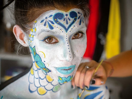 Model Lola Rose has her body painted by Anahy Nuñez at her Atom Bomb Studio in Las Cruces. A typical full-body painting by Nuñez can take up to 10 hours.