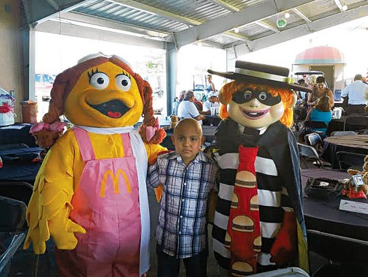 Eder Soto, 8, a guest at the Ronald McDonald House in El Paso from Juárez, poses with McDonald's characters at the Southwest Airlines/Ronald McDonald House Charities Fundraising Golf Tournament & Auction at the Las Cruces Country Club at Sonoma Ranch  in July.