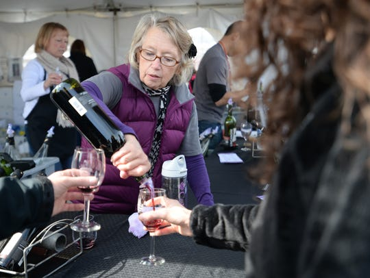 Harriet Fostervold pours a glass of wine at the Linganore