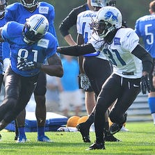 Rashean Mathis covers Calvin Johnson during a training camp practice last month.