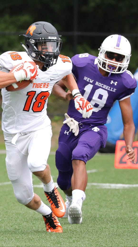Mamaroneck's Tanner Conlon runs ahead of New Rochelle's