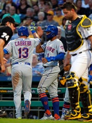 New York Mets' Asdrubal Cabrera (13) celebrates with