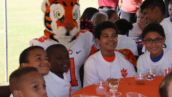 The Clemson Tiger was on hand to greet and play with children from the Anderson County Boys and Girls Club as they received tickets for an upcoming football game.