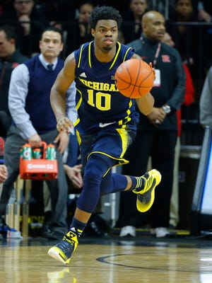 Jan 20, 2015; Piscataway, NJ, USA;  Michigan Wolverines guard Derrick Walton Jr. (10) brings the ball up court during the first half against the Rutgers Scarlet Knights at the Louis Brown Athletic Center.