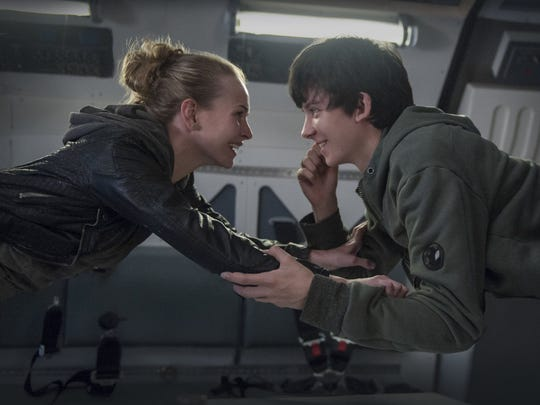 """Britt Robertson and Asa Butterfield in a scene from the movie """"The Space Between Us"""" directed by Peter Chelsom. The movie is playing at Regal West Manchester Stadium 13 and R/C Hanover Movies."""