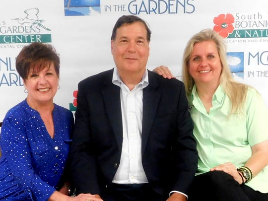 Event chairs Shirley Mims (left to right), Larry Dreier and auction chair Denise Housler