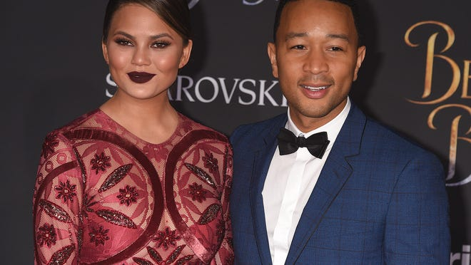 """HOLLYWOOD, CA - MARCH 2:  Chrissy Teigen and John Legend at the premiere of Disney's """"Beauty and the Beast"""" at the El Capitan Theatre on March 2, 2017 in Hollywood, California. (Photo by Scott Kirkland/PictureGroup) *** Please Use Credit from Credit Field ***"""