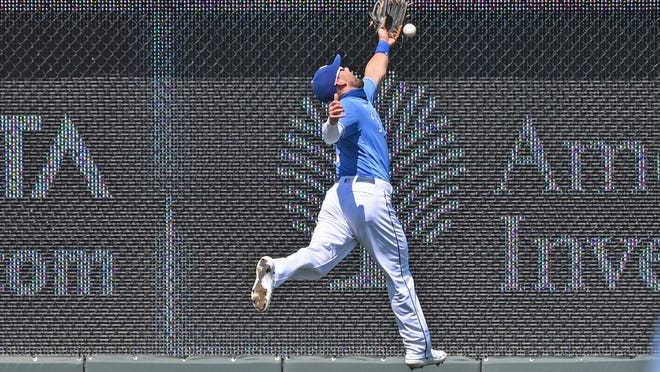 Kansas City Royals left fielder Alex Gordon (4) makes a leaping attempt on a double hit by Minnesota Twins shortstop Jorge Polanco during the fourth inning of Sunday's game at Kauffman Stadium. The Twins claimed a 5-4 win.