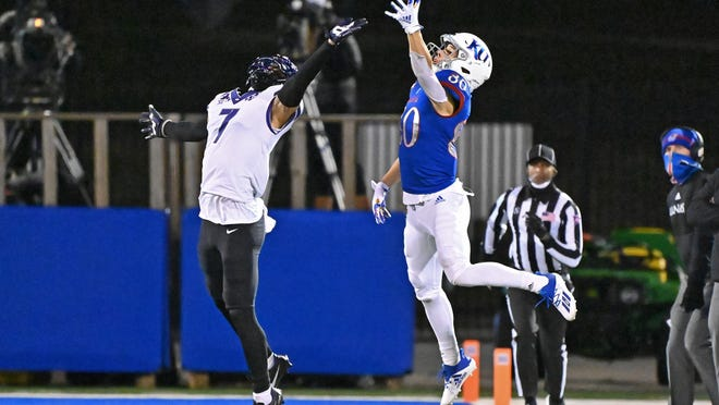 Kansas wide receiver Luke Grimm, right, goes up for a pass during the fourth quarter of last Saturday's 59-23 defeat to TCU at David Booth Kansas Memorial Stadium in Lawrence. Grimm, a true freshman, four catches for 72 yards and a pair of touchdowns in that contest.