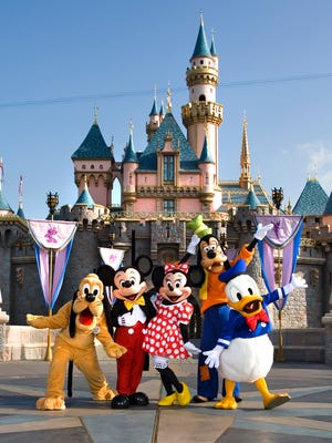 The classic Disney characters welcome visitors outside Sleeping Beauty Castle at Disneyland in Anaheim, Calif. (L-R) Pluto, Mickey Mouse, Minnie Mouse, Goofy and Donald Duck.