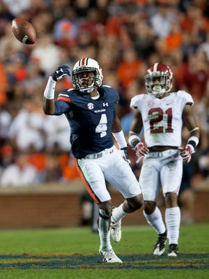 Auburn wide receiver Jason Smith (4) catches a tipped ball for a touchdown against Alabama defensive back Maurice Smith (21) during the Iron Bowl at Jordan-Hare Stadium in Auburn, Ala. on Saturday November 28, 2015. (Mickey Welsh / Montgomery Advertiser)