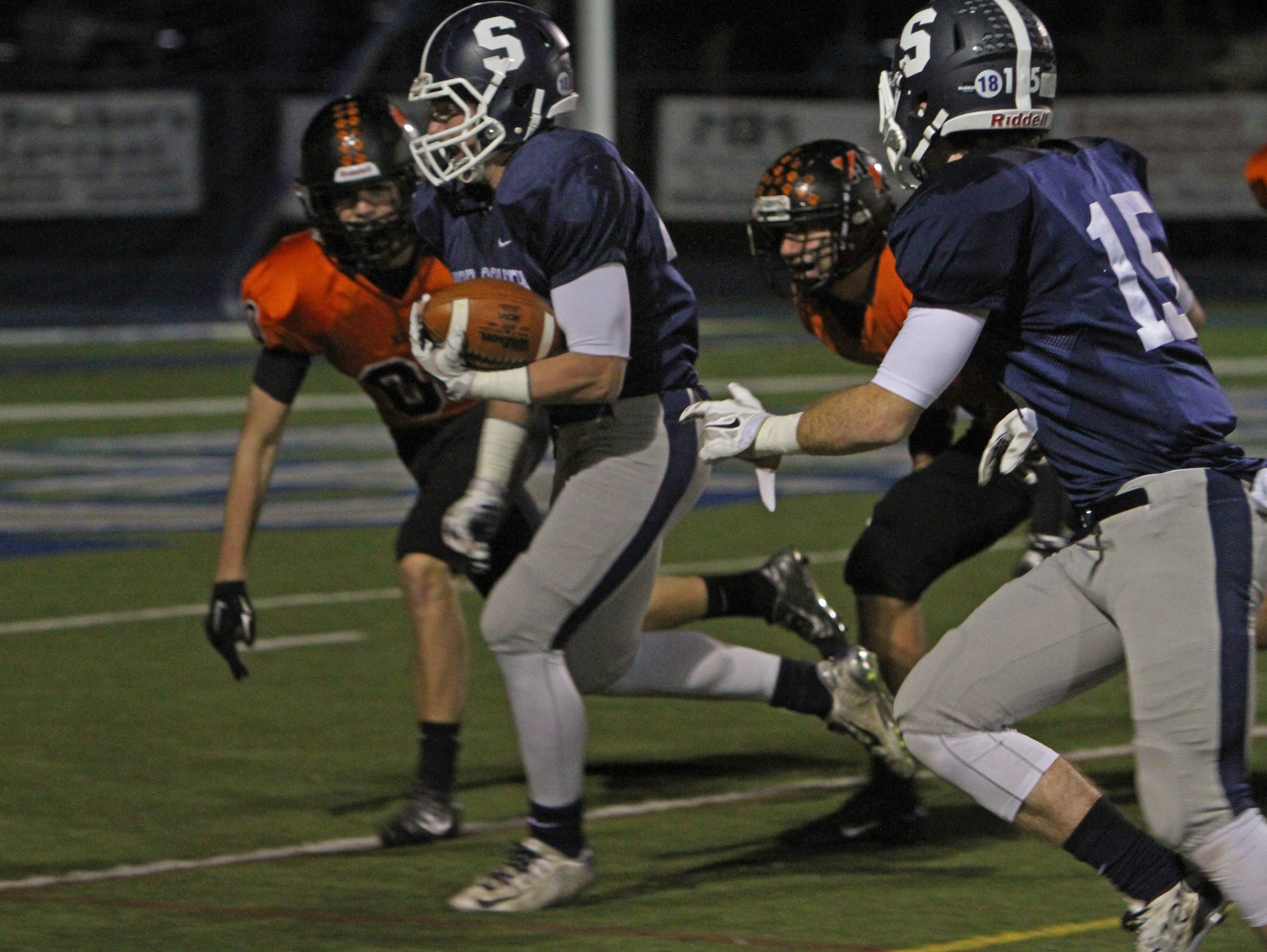 Middletown South's Cole Rogers takes the ball through left side and in for a his team's first touchdown of game. Middletown North vs Middletown South in NJSIAA North II Group IV semifinal football in Middletown, NJ on November 20, 2015