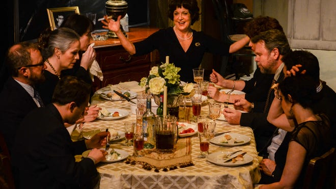Violent Weston (Barbara Deering, middle) presides over family dinner following the funeral for her husband.