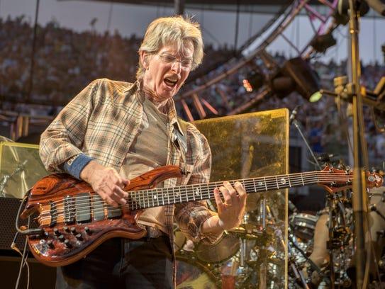 Phil Lesh of The Grateful Dead perform at Grateful
