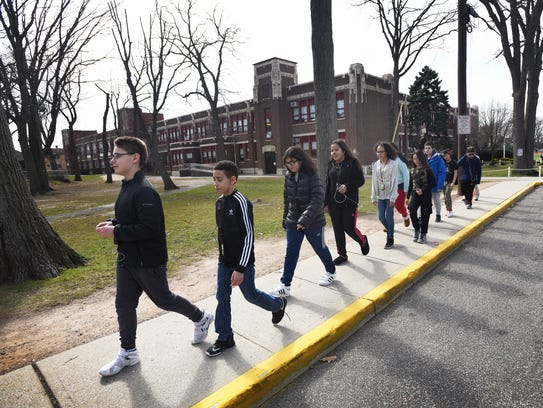 Cliffside Park sixth-grader Aiden Caceres leads classmates