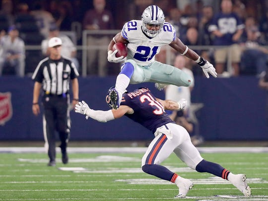 Dallas Cowboys running back Ezekiel Elliott (21) may be waiting a couple weeks to report to the team with talk of a contract extension up in the air. (Photo by Associated Press)