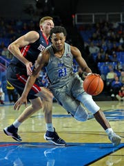 MTSU guard David Simmons drives to the basket in a