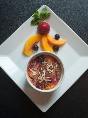 """""""Hearty, healthy"""" peach crumble. The dish, made with peaches, strawberries and Amarene cherries, sprinkled with coconut, is both dairy and gluten free. 18 October 2016"""