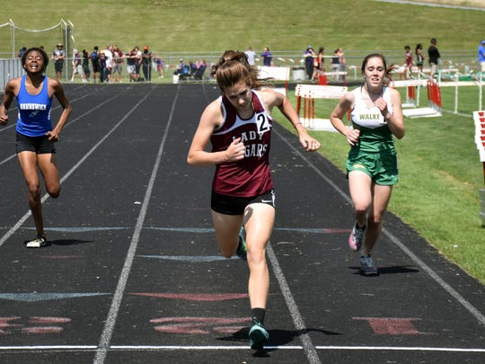 Stuarts Draft's Jordan Ramsey crosses the finish line in her heat for the girls 400-meter run at the VHSL Region 2A East track championships on Friday, May 26, 2017, at East Rockingham High School in Elkton, Va.