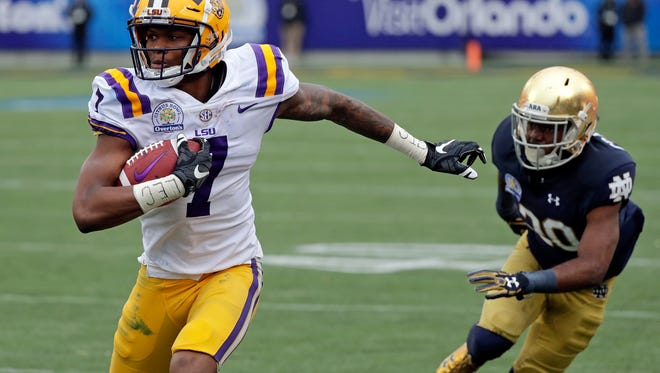LSU wide receiver DJ Chark (7) runs past Notre Dame cornerback Shaun Crawford during the first half of the Citrus Bowl on Jan. 1, 2018, in Orlando, Fla.