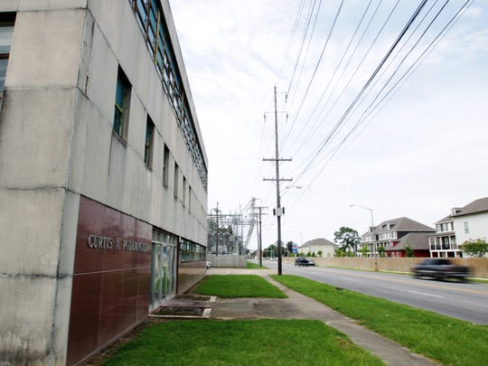 The Curtis A. Rodemacher Power Plant, which was retired from use in 1993, is pictured Thursday, July 17, 2014 on Pinhook Road in Lafayette, La. Although the building is no longer used for power generation, LUS uses the space for storage, and the electrical substation on the property is still in use.