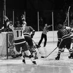 Steven Christoff and Neal Broten (right) raise their sticks after Mike Eruzione's goal during the United States' 5-1 win over Norway at the 1980 Olympics in Lake Placid.