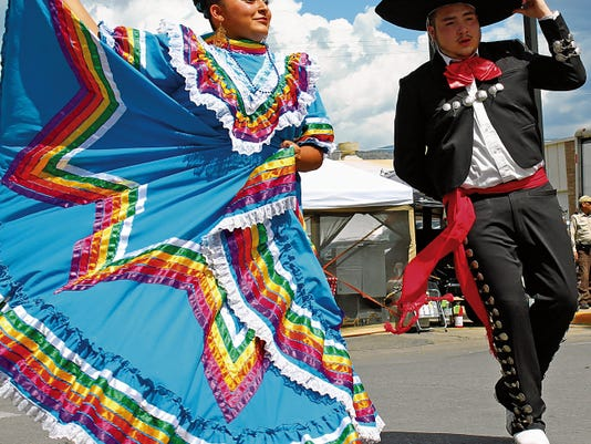 Folklorico dancers performed at the Alamo Aeon Adventure, a Comic-Con Cosplay festival, Saturday afternoon on New York Avenue. The Downtown Merchants Association and Alamogordo MainStreet created the event to help raise money to refurbish Historic Downtown Alamogordo.