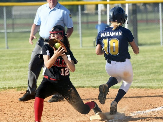Dover's Cassandra Root,left, looks for an out against Morgan Wagaman, of Greencastle, on Tuesday in the first round of the District 3 Class AAA playoffs. Wagaman was 4-for-4 with two runs scored, as the Blue Devils 5-1.