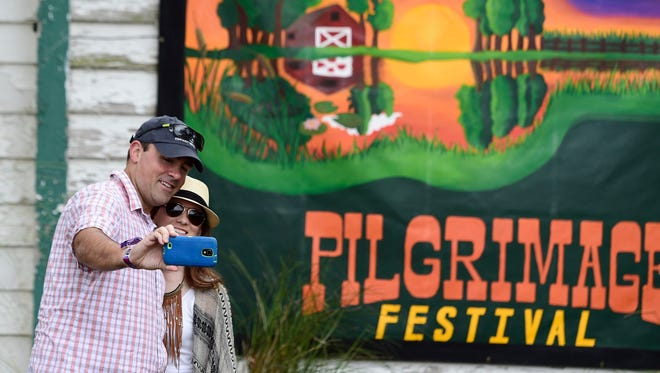 Luke and Erika Simons of Texas take a selfie Saturday at the Pilgrimage Music and Cultural Festival in Franklin.