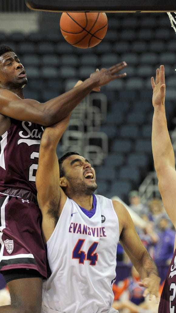 KEVIN SWANK / Special to the Courier & PressUE's David Howard, 44, (center) has his shot blocked by Southern Illinois' Armon Fletcher, 22, (left) as teammate  Rudy Stradnieks (cq) 24, helps on defense (right). The University of Evansville men's basketball team lost to Southern Illinois University 61-73 on Saturday afternoon, January 14, 2017 during their game at the Ford Center in Evansville, Ind.