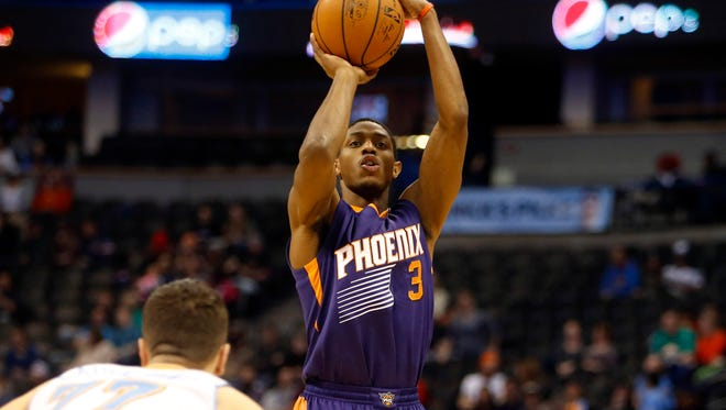 Feb 25, 2015: Phoenix Suns guard Brandon Knight (3) shoots the ball during the second half against the Denver Nuggets at Pepsi Center.  The Suns won 110-96.