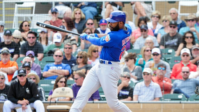 Cubs right fielder Jason Heyward hits a solo home run in the first inning.