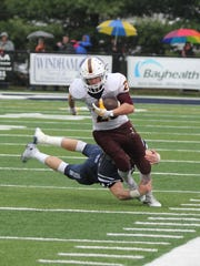 Salisbury's Brady Curley rushes in a 2015 game against