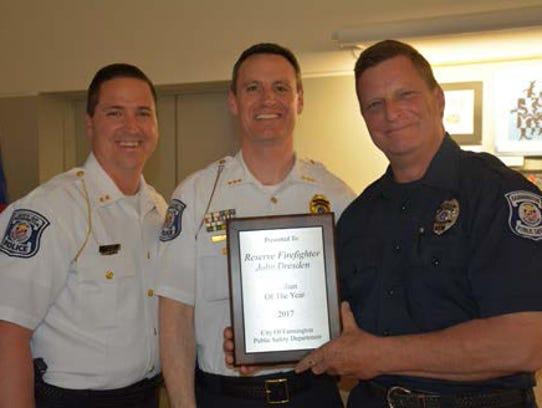 Reserve Firefighter Jon Dresden (far right) was honored