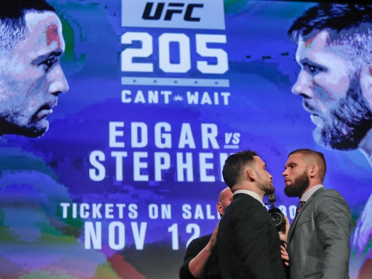 UFC fighters Frankie Edgar, left, and Jeremy Stephens pose for photos during a news conference for UFC 205, Tuesday, Sept. 27, 2016, in New York. Edgar and Stephens are on the first UFC card to be held in New York after the state legislature legalized the sport earlier this year. UFC 205 will be held at Madison Square Garden on Nov. 12. (AP Photo/Julie Jacobson)