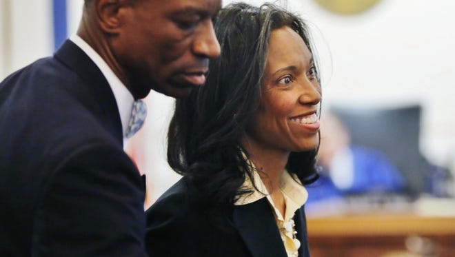 Judge Tracie Hunter in court Thursday for her criminal trial. She's with one of her self-appointed bodyguards.