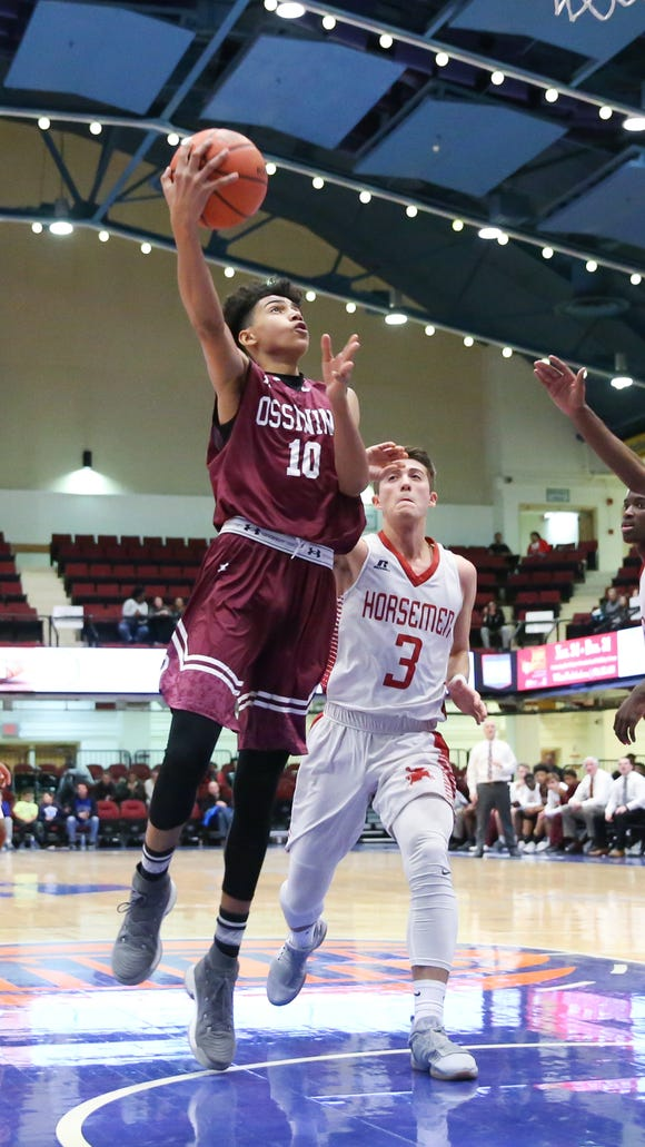 Ossining's Jacob Toppin (10) goes past Sleepy Hollow's Sean McCarthy (3) for a shot during the Slam Dunk Basketball Tournament against at The Westchester County Center in White Plains on Thursday, December 28, 2017.