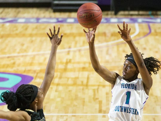 Florida SouthWestern State College Erna Normil scores against Hillsborough Community College on Tuesday at FSW in south Fort Myers. FSW beat Hillsborouh 80-64.
