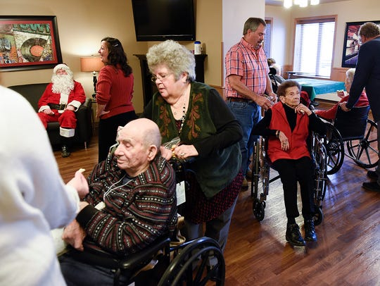Santa talked with residents, families and friends during