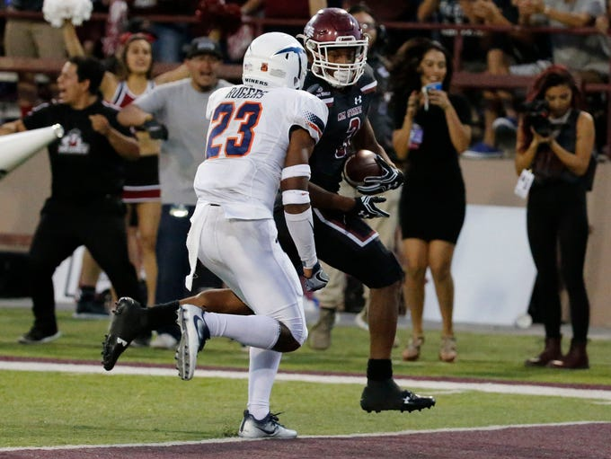 NMSU running back Larry Rose III gets the ball across