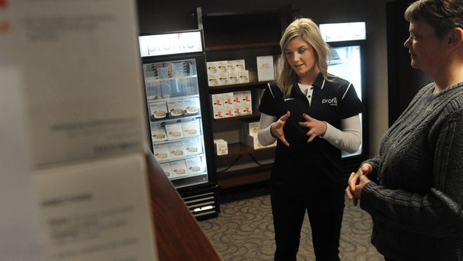Alyssa Sorenson of Profile by Sanford discusses meal options with Tami Hosman of Dell Rapids.