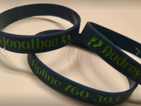 Family members distributed bracelets with the names of Jonathan Reynoso and Audrey Moran. The pair disappeared in May 2017 and Thursday is the one-year anniversary of their disappearance.