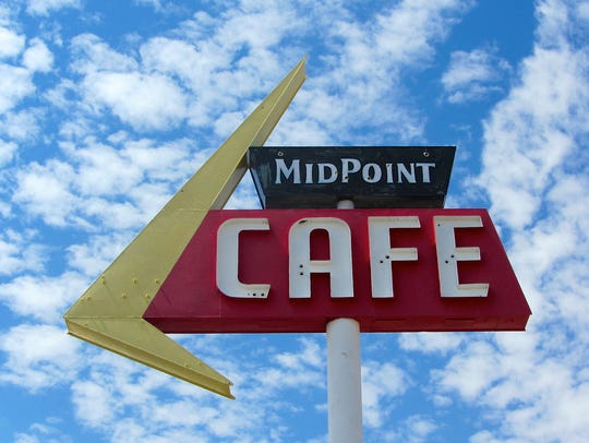 The neon sign of Midpoint Cafe, which is the oldest