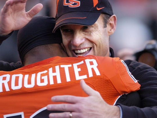 Coach Mike Riley hugs Sammie Stroughter before Oregon and Oregon State tangle in the annual Civil War football game at Reser Stadium in Corvallis, Nov. 29, 2008. THOMAS PATTERSON | Statesman Journal