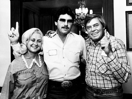 Tom T., right, and his wife, Dixie Hall, left, welcome the several hundred deejays individually as they arrive at the Hall's Fox Hollow home for a party Oct. 17, 1981. With the Halls is Lynn Waggoner of KEBC in Oklahoma City, who was voted the CMA's top major market deejay this year.