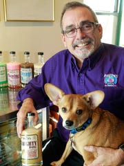 Phil Orlenko's dog Wilbur has his photo on the Naughty Dog creme liqueur Orlenko created.