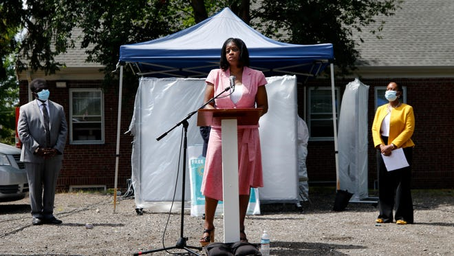 Womazetta Jones, secretary of the Executive Office of Health and Human Services, talks about Lifespan's mobile testing initiative outside the Bethel AME Church in Providence on Monday.