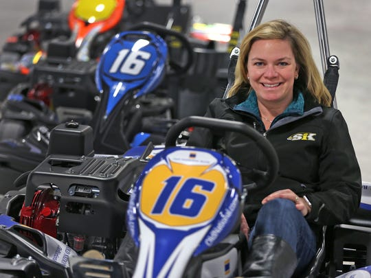 IndyCar driver Sarah Fisher sits in a go-cart at  her Speedway Indoor Karting.